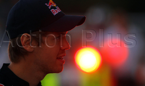 07.10.2010 German driver Sebastian Vettel of Red Bull Racing watches the pistop training at Suzuka Circuit in Suzuka, Japan. The 2010 Formula 1 Japanese Grand Prix is held on 10 October.