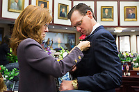 TALLAHASSEE, FLA. 3/4/14-Rep. Seth McKeel, R-Lakeland, gets some help with his boutonniere from his wife Kim prior to the start of the opening day of the legislative session, March 4, 2014 at the Capitol in Tallahassee.<br /> <br /> COLIN HACKLEY PHOTO