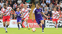Danny Hylton of Luton Town gets away from two Stevenage defenders during the Sky Bet League 2 match between Stevenage and Luton Town at the Lamex Stadium, Stevenage, England on 20 August 2016. Photo by Liam Smith.