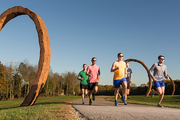 November 11, 2015. Raleigh, NC.<br /> Pat Price (yellow shirt), Keith Ferguson (grey shirt), Rob Aldina (red shirt) Anthony Greco (green shirt) and David Meeker (blue shirt) run along the North Carolina Museum of Art's greenway trails.