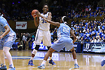 01 March 2015: Duke's Amber Henson (30) and North Carolina's N'Dea Bryant (22). The Duke University Blue Devils hosted the University of North Carolina Tar Heels at Cameron Indoor Stadium in Durham, North Carolina in a 2014-15 NCAA Division I Women's Basketball game. Duke won the game 81-80.