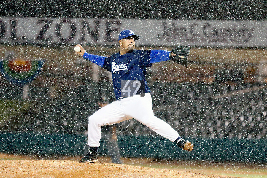21 September 2012: Keino Perez pitches as the rain falls during France vs South Africa tie game 2-2, rain delayed at the end of the 9th inning at 1 AM, during the 2012 World Baseball Classic Qualifier round, in Jupiter, Florida, USA. Game to resume 22 September 2012 at noon.