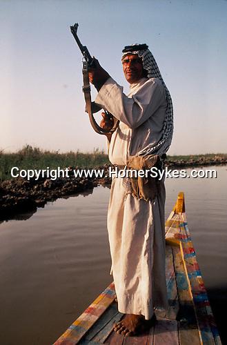 Marsh Arabs. Southern Iraq. Circa 1985. Marsh Arab man with rifle. Haur al Mamar or Haur al-Hamar marsh collectively known now as Hammar marshes Irag 1984