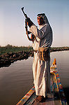 Marsh Arabs. Southern Iraq. Circa 1985. Marsh Arab man with rifle. Haur al Mamar or Haur al-Hamar marsh collectively known now as Hammar marshes Irag 1984