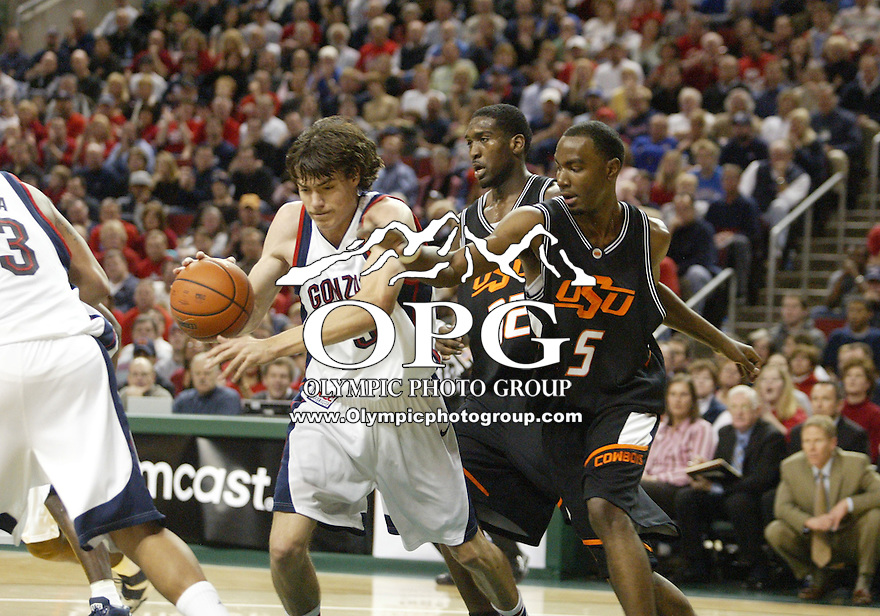 10 December 2005: Gonzaga Bullsdogs forward #3 Adam Morrison pulls down a rebound in front of Oklahoma State Cowboys forward #05 Marcus Dove during the third annual battle in Seattle held at Key Arena in Seattle, WA.