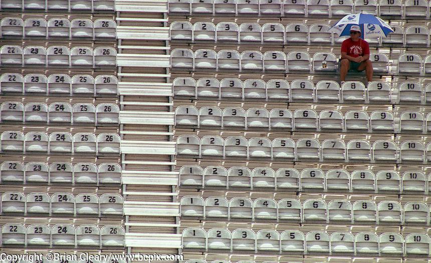 NASCAR fan umbrella sun rain grandstand Pepsi 400 at Daytona International Speedway in Daytona beach, FL on July 1, 1989. (Photo by Brian Cleary/www.bcpix.com)