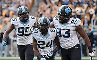 North Carolina defensive players Kareem Martin (95), Terry Shankle (24) and Tim Jackson (93) celebrate a tackle. The North Carolina Tar Heels defeated the Pitt Panthers 34-27 at Heinz Field, Pittsburgh Pennsylvania on November 16, 2013.