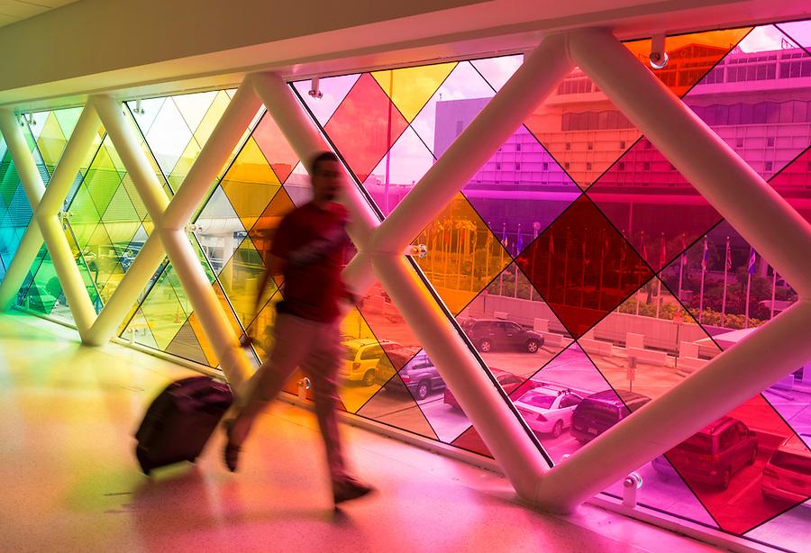 Passenger rushing out in the Miami International Airport, rainbow bridge.