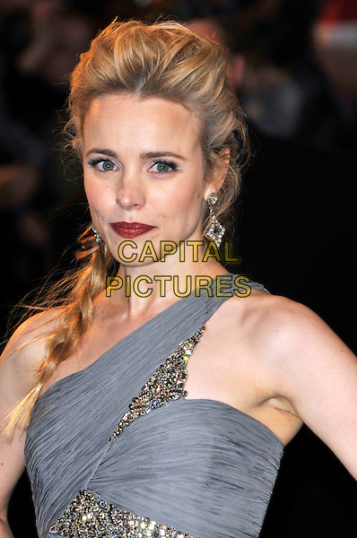 "RACHEL McADAMS .Attending the World Premiere of ""Sherlock Holmes"", Empire cinema Leicester Square, London, England, UK, .December 14th 2009..arrivals portrait headshot red lipstick make-up grey gray one shoulder jewel encrusted beaded crystals jewelled embellished hair plait braid earring .CAP/PL.©Phil Loftus/Capital Pictures."