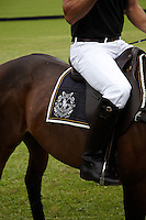 The saddlecloth of Nacho Figueras' mount displays the logo of The Black Watch team, sponsored by Ralph Lauren
