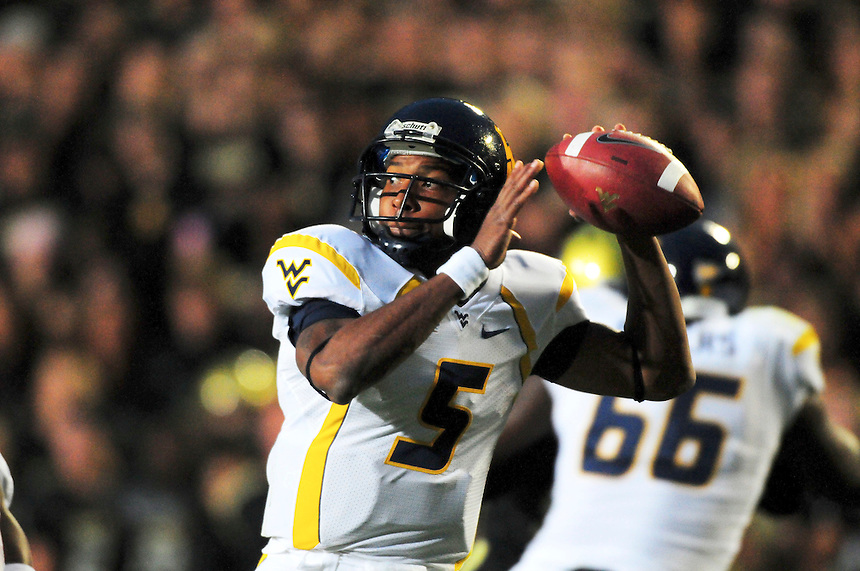 18 September 08: West Virginia quarterback Pat White passes against Colorado. The Colorado Buffaloes defeated the West Virginia Mountaineers 17-14 in overtime at Folsom Field in Boulder, Colorado. For Editorial Use Only.