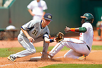 Chantz Mack #2 of the Miami Hurricanes steals third base as Sam Dove #31 of the Georgia Tech Yellow Jackets fields the throw at the 2012 ACC Baseball Championship at NewBridge Bank Park on May 27, 2012 in Winston-Salem, North Carolina.  The Yellow Jackets defeated the Hurricanes 8-5.  (Brian Westerholt/Four Seam Images)
