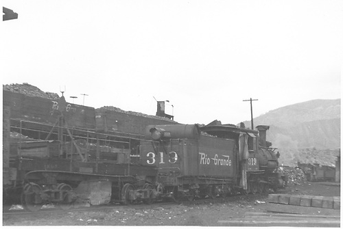 3/4 rear engineer's-side view of D&amp;RGW #319 in the Durango yards coupled to an RGS flanger.<br /> D&amp;RGW  Durango, CO
