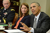 United States President Barack Obama (R) makes remarks as Chairman of the Joint Chiefs Gen. Martin Dempsey (L) and US Secretary of Health and Human Services Sylvia Burwell listen during a meeting with his national security team and senior staff for an update on the Ebola crisis in West Africa, at the White House, October 6, 2014, in Washington, DC.   <br /> Credit: Mike Theiler / Pool via CNP