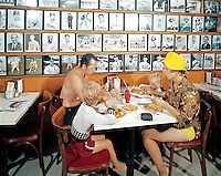 All Star Motel Restaurant, Wildwood, NJ with a family of 4 eating hamburgers and french fries. 1960's retro photograph.