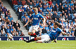 Jon Daly slides in to claim his fouth goal and the fifth of the match for Rangers