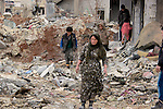 25/2/2015-- Kobane,Syria-- A family of Kobane searching for anything that could be used again after the gunfire of coalition forces and ISIS.