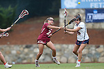 CHAPEL HILL, NC - MAY 12: Elon's Nicole Sinacori (21) scores Elon's first goal past Virginia's Lauren Martin (35). The Elon University Phoenix played the University of Virginia Cavaliers on May 12, 2017, at Fetzer Field in Chapel Hill, NC in an NCAA Women's Lacrosse Tournament First Round match. Virginia won the game 11-9.
