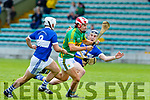 Lixnaw's Jeremy McKenna been closed down by St Brendans Daniel Finnegan and Kevin Hanafin in the Qtr final of the Senior Hurling Championship in Austin Stack Park on Sunday.