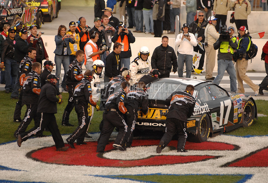 Feb 25, 2007; Fontana, CA, USA; Nascar Nextel Cup Series driver Matt Kenseth (17) is pushed into victory lane after winning the Auto Club 500 at California Speedway. Mandatory Credit: Mark J. Rebilas