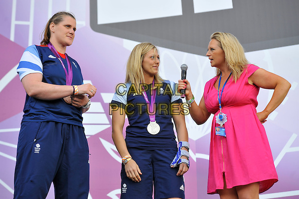 Karina Bryant and Gemma Gibbons of Team GB attending BT London Live, Hyde Park, London, England, UK, .4th August 2012..Olympics Great Britain half length medals medal team tracksuit top t-shirt bronze silver medalists .CAP/MAR.© Martin Harris/Capital Pictures.