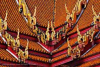 Ornate rooftop architecture of the Ordination Hall (Ubosot Hall) at Wat Benchamabophit, Bangkok, Thailand