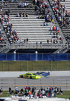 Nov. 1, 2009; Talladega, AL, USA; NASCAR Sprint Cup Series driver Paul Menard (98) and Joe Nemechek (87) crash during the Amp Energy 500 at the Talladega Superspeedway. Mandatory Credit: Mark J. Rebilas-