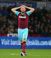 James Collins of West Ham United shows a look of frustration during the Barclays Premier League match between Swansea City and West Ham United played at The Liberty Stadium, Swansea on 20th December 2015