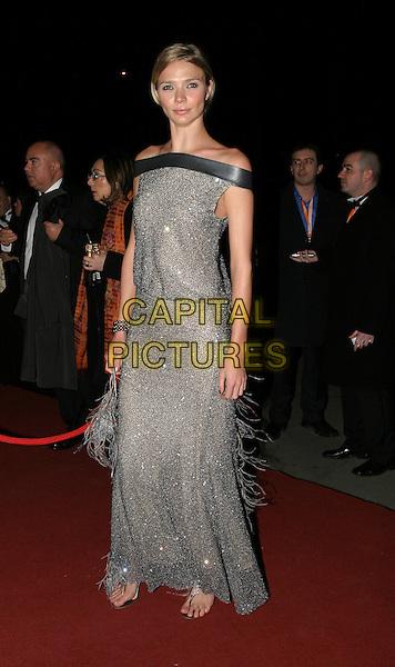 JODIE KIDD.Bafta Awards - British Academy Awards.15 February 2004.full length, full-length, long grey sparkly metallic tassle dress.www.capitalpictures.com.sales@capitalpictures.com.© Capital Pictures.