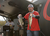 NWA Democrat-Gazette/FLIP PUTTHOFF <br /> Jason Sandidge of Centerton is the leading co-angler. He weighed five bass on Thursday totaling 13 pounds, 14 ounces.