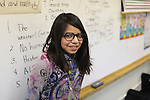 Hebard Elementary student Alicia Munguia, 11, leans against a dry erase board in her classroom earlier this month. The 6th grader said the weather and how easy it is to get along with everyone was what she liked most about living in Laramie County. Michael Smith/staff