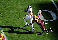 Nov. 28, 2009; Tempe, AZ, USA; Arizona State Sun Devils wide receiver (32) Jamal Miles dives to tackle Arizona Wildcats wide receiver (19) William Wright at Sun Devil Stadium. Arizona defeated Arizona State 20-17. Mandatory Credit: Mark J. Rebilas-