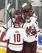 The Eagles celebrate a goal. - The Boston College Eagles defeated the visiting University of Massachusetts Lowell River Hawks 3-0 on Friday, February 21, 2014, at Kelley Rink in Conte Forum in Chestnut Hill, Massachusetts.