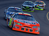 Nov 13, 2005; Phoenix, Ariz, USA;  Nascar Nextel Cup driver Jeff Gordon driver of the #24 Dupont Chevy leads a pack of cars during the Checker Auto Parts 500 at Phoenix International Raceway. Mandatory Credit: Photo By Mark J. Rebilas