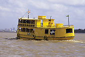"Belem, Brazil. Gaiola riverboat of the Brazilian postal service ""correios"" painted yellow and blue on the Amazon river."