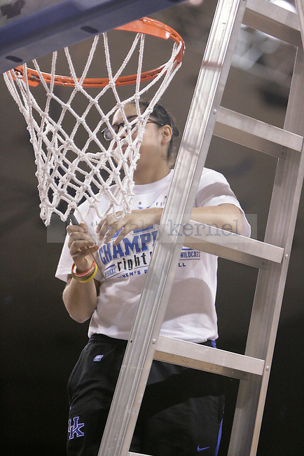 Sophomore Jennifer O' Neill cuts down a piece of the net during the Kentucky Women's celebration of winning the SEC regular season championship 2/26/12 at Memorial Coliseum in Lexington, Ky. Photo by Quianna Lige | Staff