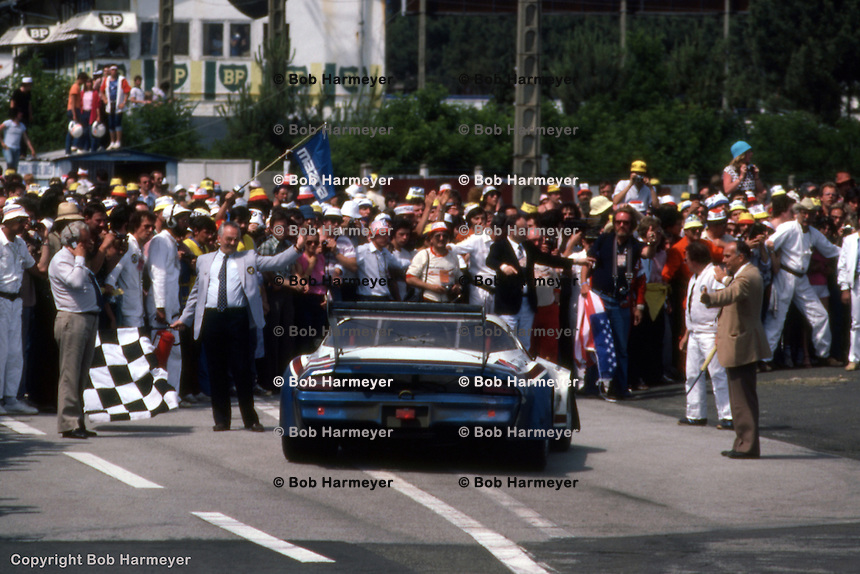 LE MANS, FRANCE: The Chevrolet Camaro driven by Tom Williams, Dick Brooks and Hershel McGriff is waved off the track at the finish of the 24 Hours of Le Mans on June 20, 1982, at Circuit de la Sarthe in Le Mans, France.