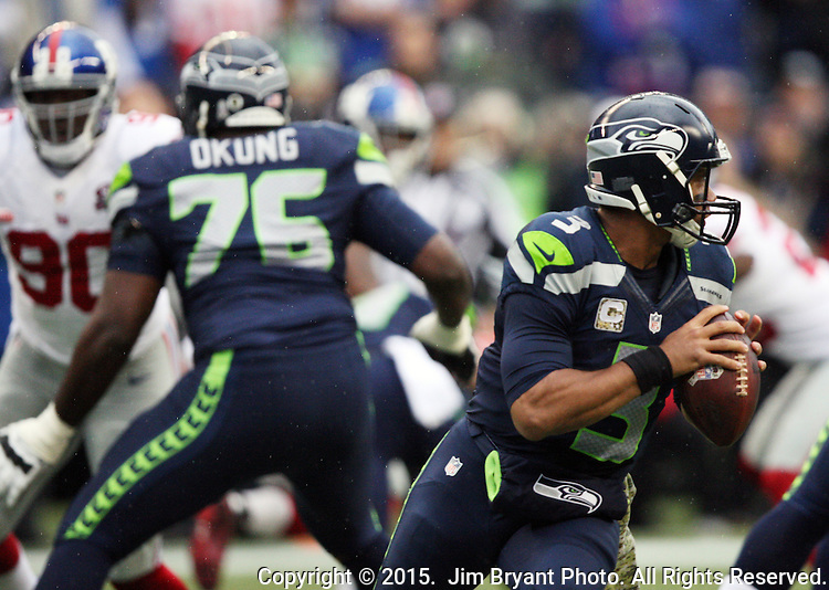 Seattle Seahawks quarterback Russell Wilson scrambles against the New York Giants at CenturyLink Field in Seattle, Washington on November 9, 2014. The Seahawks  beat the Giants 38-17.  ©2014. Jim Bryant Photo. All rights Reserved.
