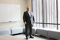 Daniel P. McGahn is President & CEO of American Superconductor, also known as AMSC, an energy technology company based in Ayer, Massachusetts, USA, seen here in the company's new headquarters in Ayer, on Tues., Jan. 30, 2018. AMSC was the victim of the theft of trade secrets, starting in 2011 when the Chinese company Sinovel worked to steal and modify AMSC's proprietary wind turbine-running software. Sinovel was AMSC's largest customer, and McGahn estimates that 70% of China's wind turbines now run software stolen from AMSC. AMSC has received favorable judgments from American and Chinese courts, and the company contends that it is owed billions of dollars as a result of the theft, which almost destroyed the company. When news of the theft came out, the company's stock value decreased substantially and went from approximately 800 employees to fewer than 200. The company has rebounded some since the crime.