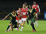 Bogotá- Independiente Santa Fe y Deportes Quindío, empataron a dos goles en el encuentro correspondiente al juego de vuelta de los cuartos de final, desarrollado el 8 de octubre en el estadio Nemesio Camacho el Campín.
