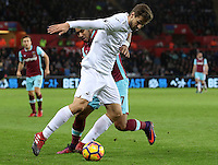 Gylifi Sigurdsson of Swansea City FC is tackled by Dimitri Payet of West Ham United during the Premier League match between Swansea City and West Ham United at The Liberty Stadium, Swansea, Wales, UK. Monday 26 December 2016
