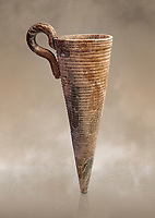 Minoan stone conical rhython with carved ring decoration, Zakros 1500-1400 BC; Heraklion Archaeological  Museum.