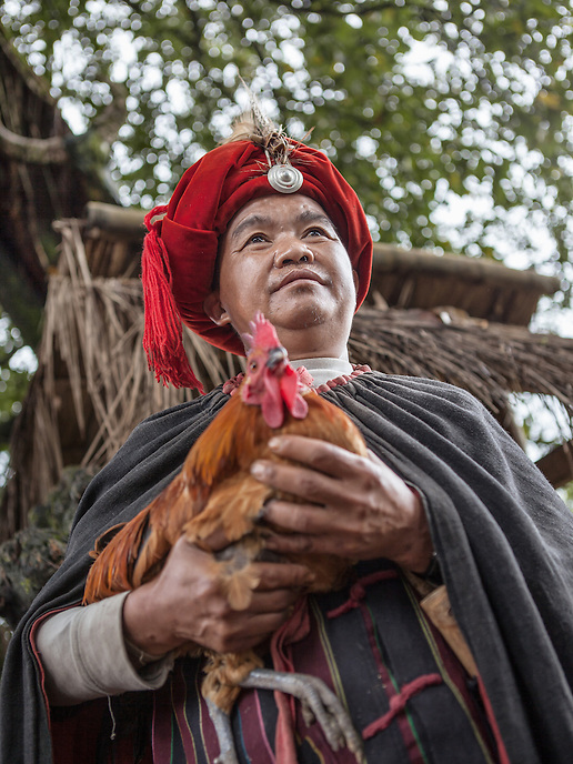 """A Wa village elder in the village of Wengding. The Wa, which literally means """"mountain dwellers"""", is the hilltribe that inhabit the Sino-Burmese. Known as one of the last headhunting tribe until mid-twentieth century, their population in both countries now approximately no more than one million. In the homogenous society of modern China, Wa is one of more than 50 officially state-recognized ethnic minorities. They can be found around the southwestern corners of Yunnan province."""