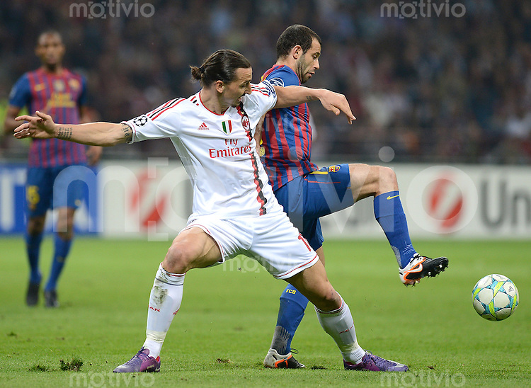 FUSSBALL   CHAMPIONS LEAGUE  VIERTELFINAL-HINSPIEL   2011/2012      AC Mailand - FC Barcelona             28.03.2012 Zlatan Ibrahimovic (li, AC Mailand) gegen Sergio Busquets (Barca)