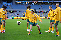 MELBOURNE, AUSTRALIA - OCTOBER 14: Brett Holman from Australia warming up with team mates in a AFC Asian Cup 2011 match between Australia and Oman at Etihad Stadium on October 14, 2009 in Melbourne, Australia. Photo Sydney Low www.syd-low.com