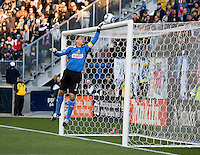 Faryd Mondragon (1) of the Philadelphia Union tips the ball over the bar during the game at PPL Park in Chester, PA.  Houston defeated Philadelphia, 2-1, to take home the one goal advantage in the home and home series..