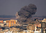 Smoke rises following what witnesses said was an Israeli air strike in Gaza August 22, 2014. Israeli forces carried out more than 25 air strikes in Gaza on Friday, killing four people, Palestinian health officials said. Israel launched its offensive on Gaza on July 8 with the stated aim of putting an end to cross-border rocket fire. More than 2,070 Palestinians have since been killed in the conflict, most of them civilians, while large areas of Gaza have been destroyed, leaving around 400,000 of the enclave's 1.8 million people displaced. Sixty-four Israeli soldiers and four civilians in Israel have been killed.. Photo by Yasser Qudih