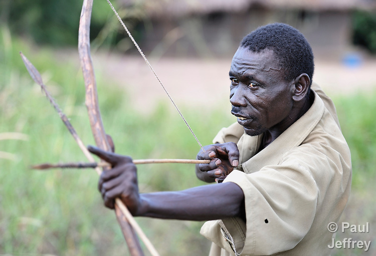 Raphael Juma goes hunting for small game with a bow and arrows in the Southern Sudan village of Pisak. The weapon is also used for self-defense against soldiers from the Lord's Resistance Army, which occasionally operates in the area. NOTE: In July 2011 Southern Sudan became the independent country of South Sudan.