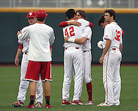 Indiana players console each other after losing to Maryland. Indiana's 3-0 loss to Maryland eliminated the Hoosiers from the Big Ten Tournament at TD Ameritrade Park in Omaha, Neb. on May 27, 2016. (Photo by Michelle Bishop)