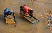 Africa, Madagascar, Ilhorombe region, Ilakaka. One of the world's largest known alluvial sapphire deposits discovered in 1998. Women panning for gold and precious minerals in the river.